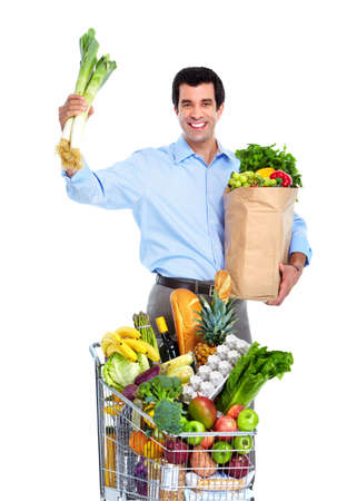 Happy man with a shopping cart. Stock Photo - 10733517
