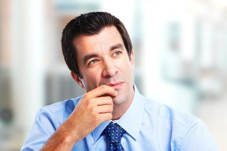 1 person: Thinking handsome businessman