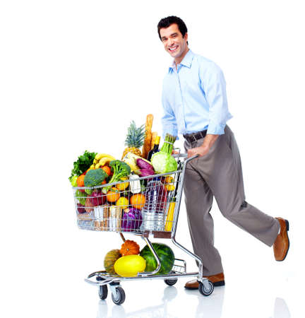 consumer: Happy man with a shopping cart. Stock Photo