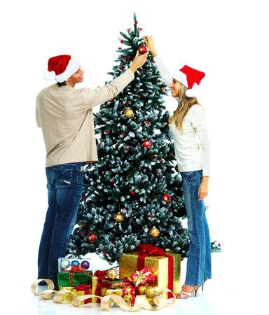 Couple and christmas tree. photo