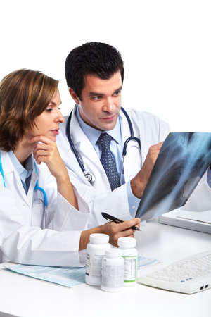 Medical doctors with x-ray. photo