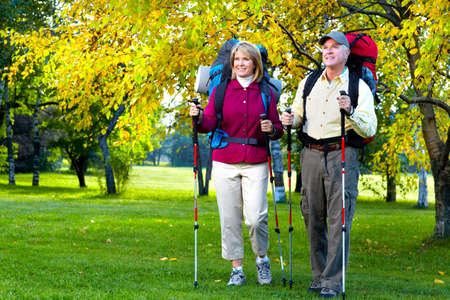 trekking pole: Hiking senior couple.