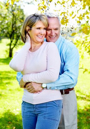 man woman hugging: Elderly couple.