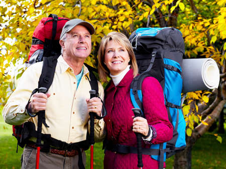 adventure sports: Hiking senior couple.