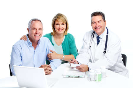 Senior couple and a doctor. photo