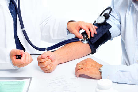 sphygmomanometer: Doctor and senior man. Stock Photo