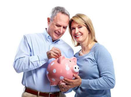 pensioner: Couple with piggy bank. Stock Photo