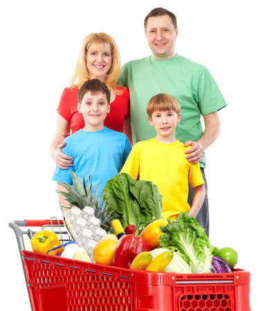 Happy family with a shopping cart. Stock Photo
