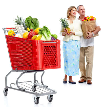 Happy couple with a shopping cart. photo