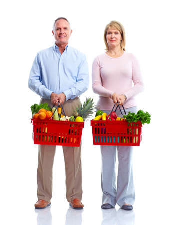Happy couple with a shopping basket. Stock Photo - 10930307