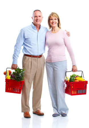 Happy couple with a shopping basket.