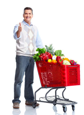 Happy man with a shopping cart. photo
