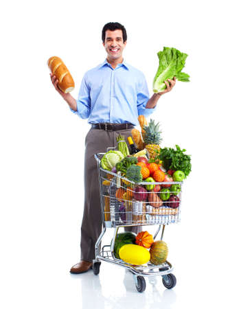 shopping cart: Happy man with a shopping cart. Stock Photo