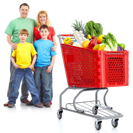 Happy family with a shopping cart. Foto de archivo