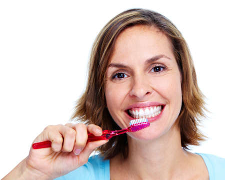 Woman with toothbrush. photo