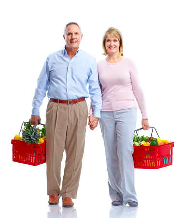 Grocery. Couple with a shopping basket. photo