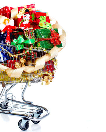 shopping trolley: Christmas shopping cart with gifts.