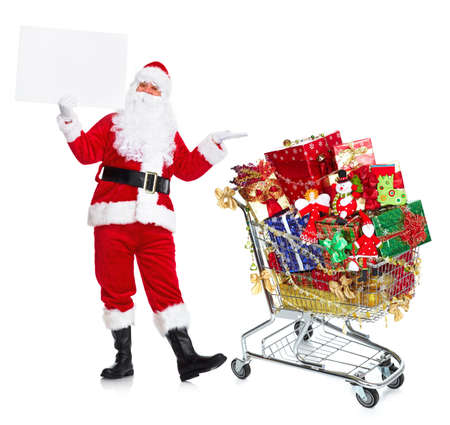 st claus: Santa Claus with shopping cart and gifts.