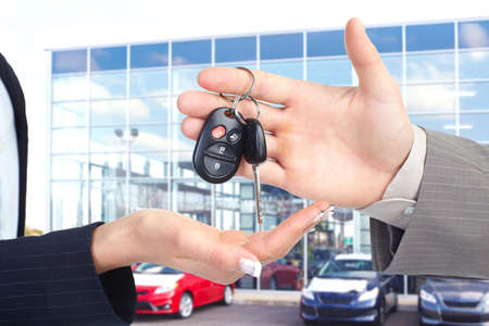 handing: Car key. Stock Photo