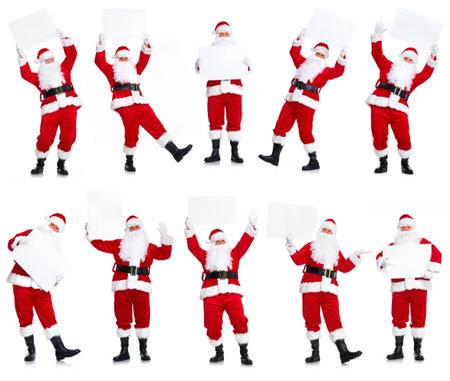 saint nick: Group of Christmas Santa Claus with poster. Stock Photo