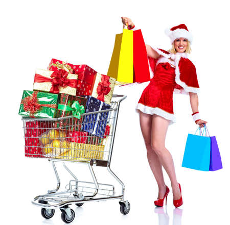 Santa helper girl with shopping cart. photo