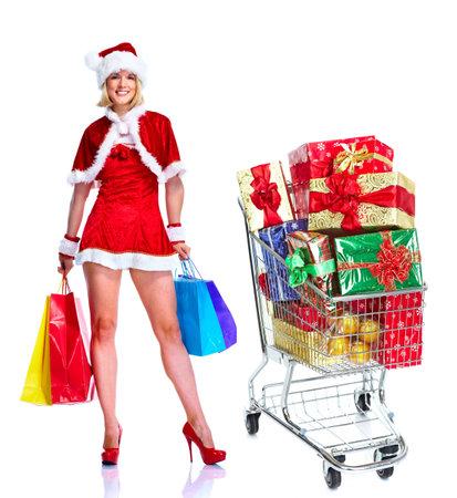 Santa helper girl with shopping cart. photo