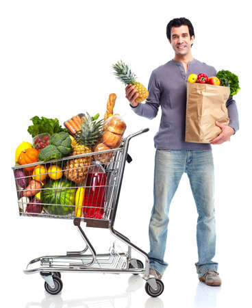 Happy man with a shopping cart. Imagens