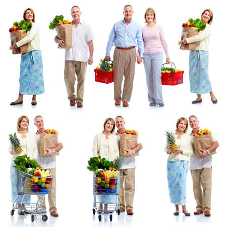 supermarket trolley: Senior couple with grocery cart. Stock Photo