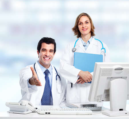 Group of medical doctors. Over blue background. photo