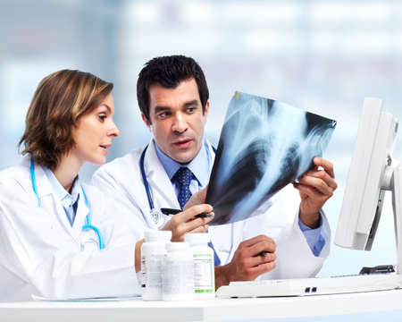 radiology: Doctors team with x-ray. Health care.