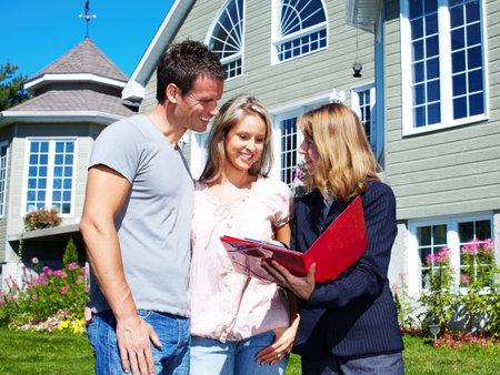 property: Happy family near new house.