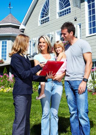 purchase: Happy family near new house.