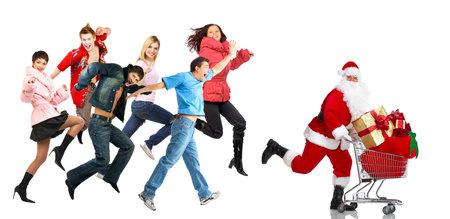 shopping cart: Christmas shopping people. Stock Photo