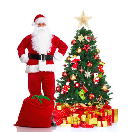 산타 클로스와 크리스마스 트리입니다. 스톡 콘텐츠