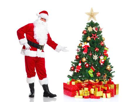 Kerstman en Kerstboom. Stockfoto