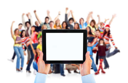Tablet computer and group of happy people. Stock Photo - 11292795