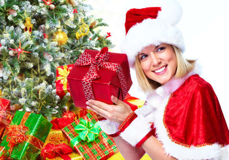 Santa helper girl with gift. photo