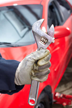auto shop: Hand with wrench. Auto mechanic.