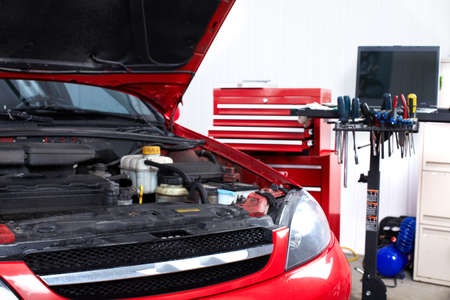 Car in auto repair shop.