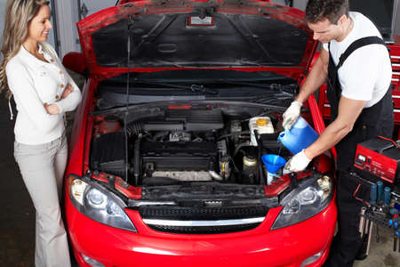 job engine: Auto mechanic and woman in auto repair shop. Stock Photo