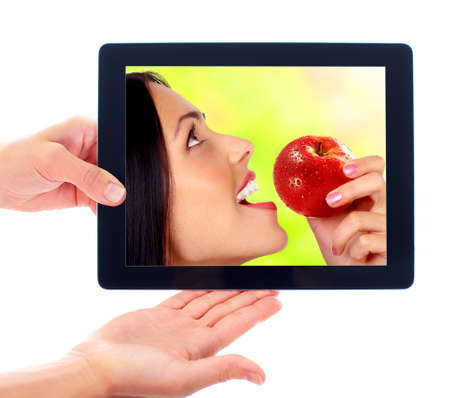apple computers: Tablet computer and woman with apple