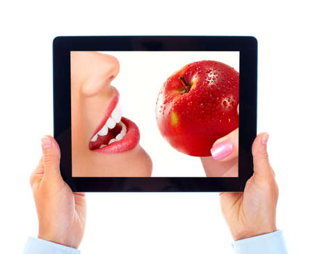 dentist smile: Tablet computer and woman with apple