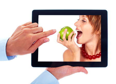 Tablet computer and woman with apple photo