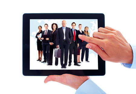 Tablet computer and group of business people. photo