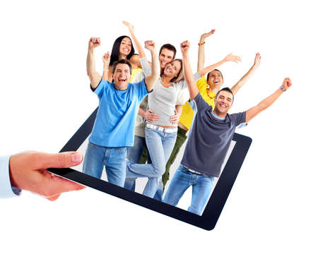 Tablet computer and group of happy people. photo