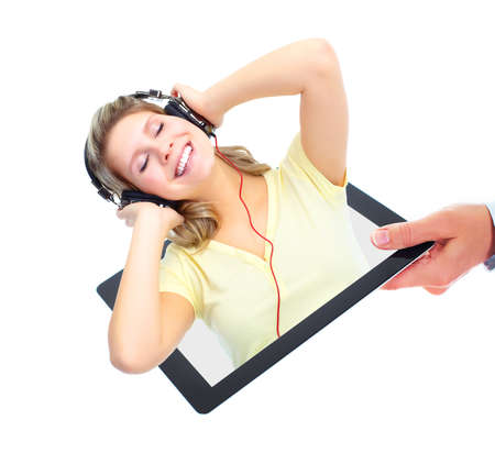 Happy girl listening music. Tablet computer. photo