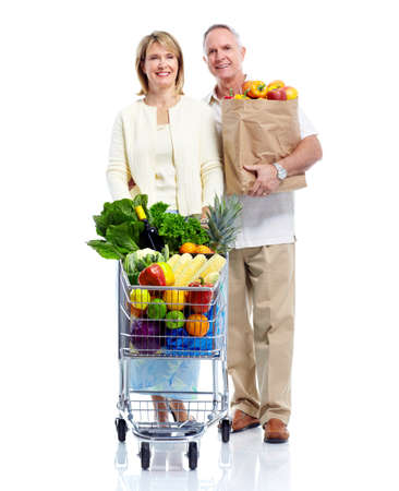 Senior couple with a shopping cart. photo