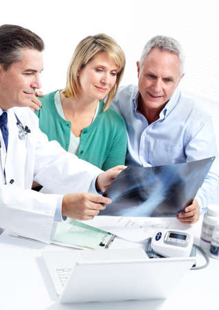 medical insurance: Doctor and patient senior couple. Stock Photo