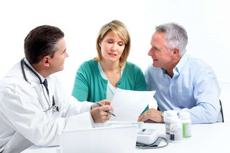 medicare: Doctor and patient senior couple. Stock Photo