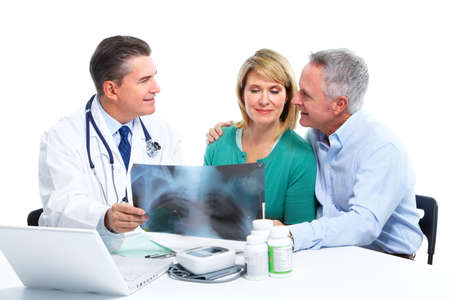 doctor laptop: Doctor and patient senior couple. Stock Photo
